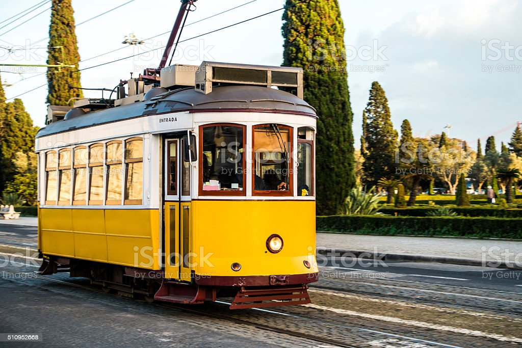 yellow tram electrico portugal lisboa lisbon copy space motion blur stock photo