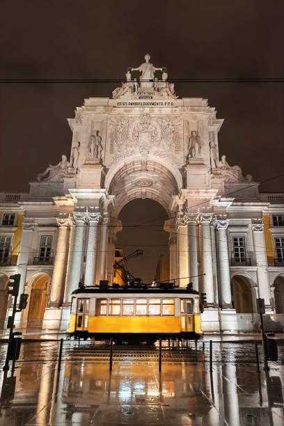 yellow tram in lisbon at night - eletrico lisboa imagens e fotografias de stock