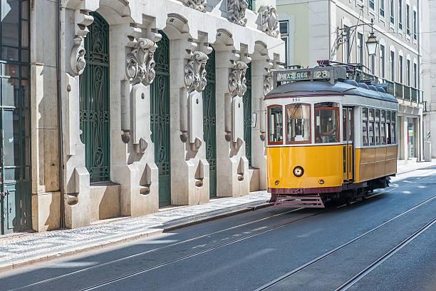 yellow tram in lisbon - spårvagn bildbanksfoton och bilder