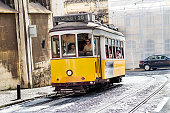Lisbon, Portugal - Aug 4, 2018: Vintage yellow tramway in the city center of Lisbon. One of the main tourist attractions
