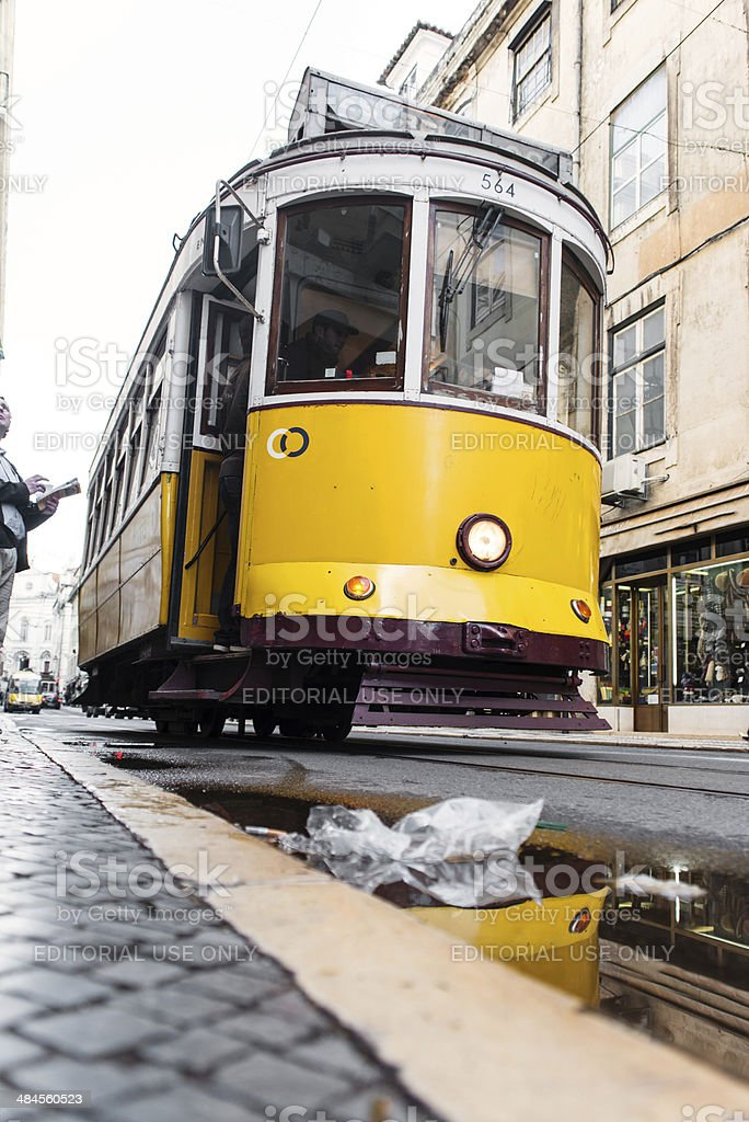 Yellow tram stops by stock photo