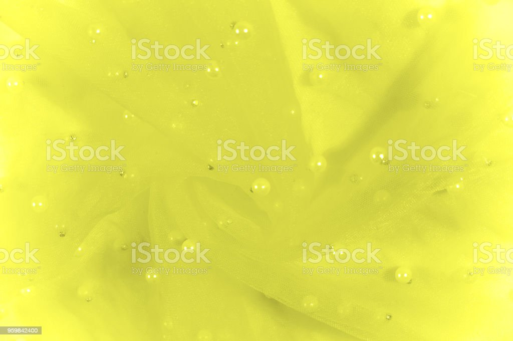 yellow translucent fabric, embroidered with beads. Glamor never rests! which can also be interpreted as lace. The epoch is decorated with beads, precious stones and rhinestones in abundance! stock photo