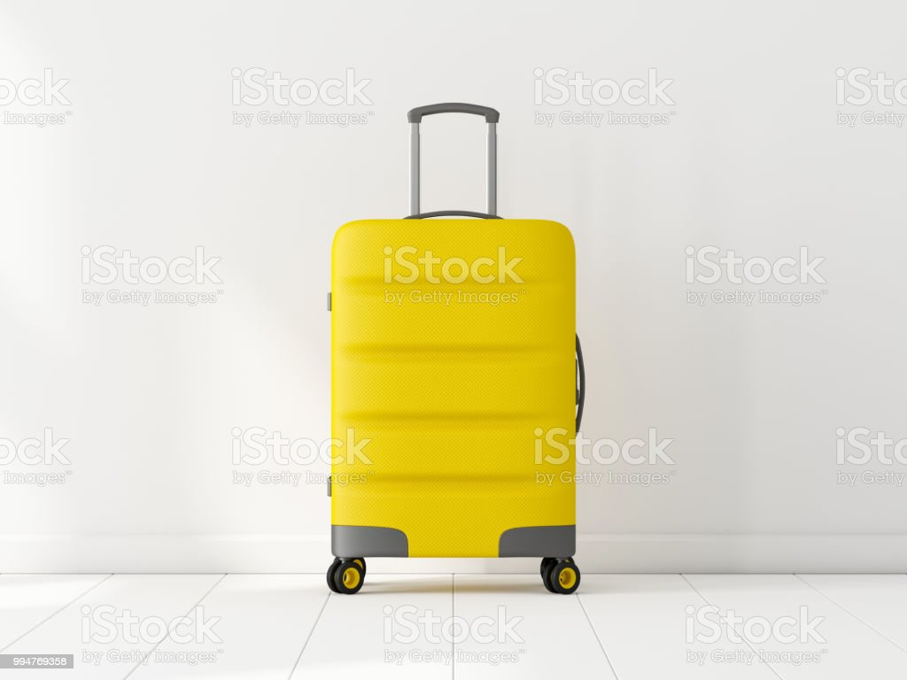 Yellow Travel cabin suitcase in white room royalty-free stock photo