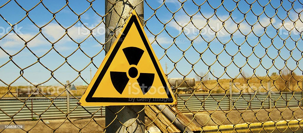 A yellow triangle radiation sign stock photo