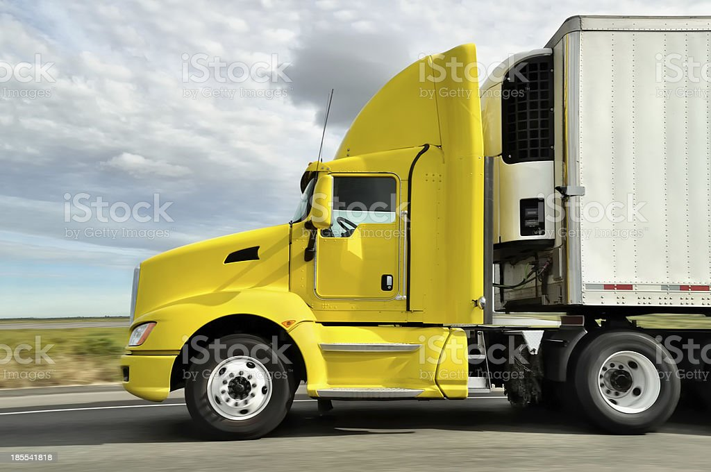 yellow truck on highway royalty-free stock photo
