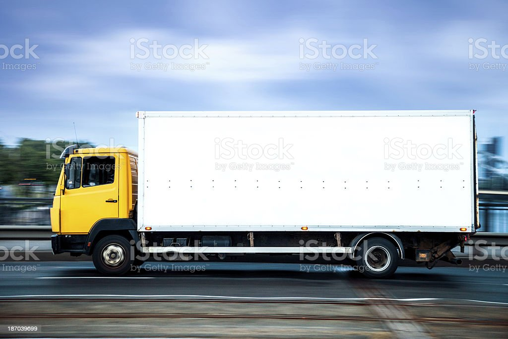 Yellow truck on the highway royalty-free stock photo