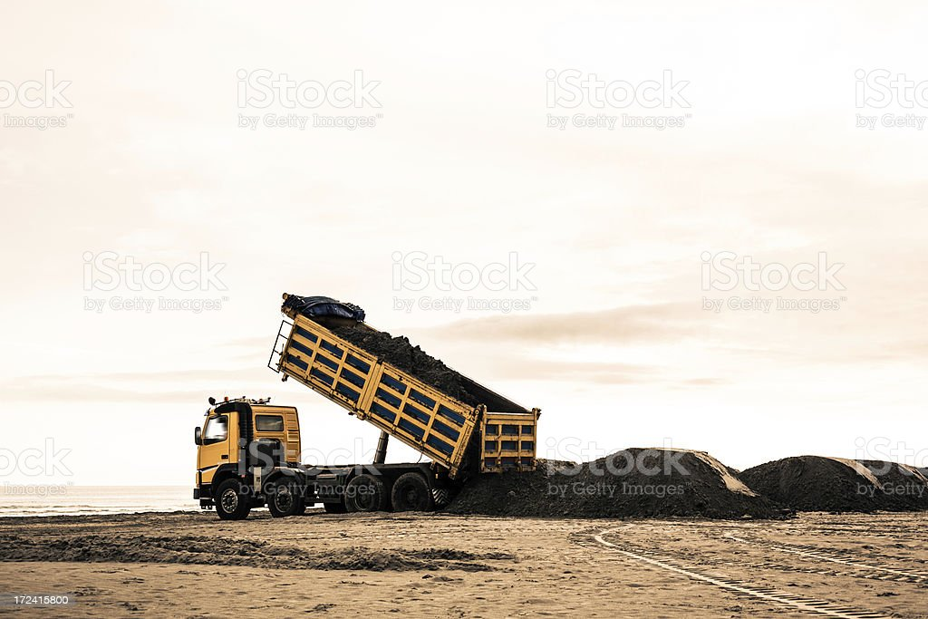 Yellow Truck Working at Construction Site on the beach royalty-free stock photo