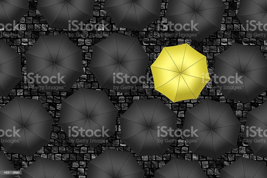 Yellow umbrella. Bright  umbrella among set of black umbrellas stock photo