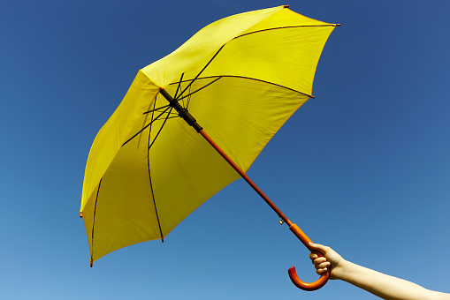 Yellow umbrella on the sky