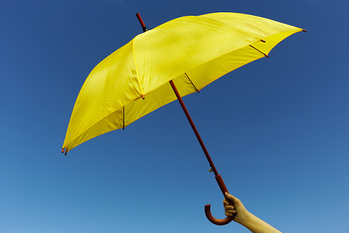 Yellow umbrella on the sky