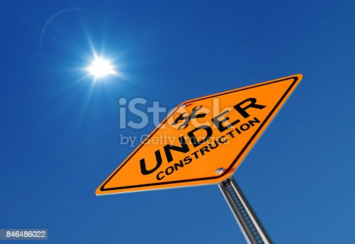 97709303 istock photo Yellow Under Construction Traffic Sign on Blue Sky 846486022