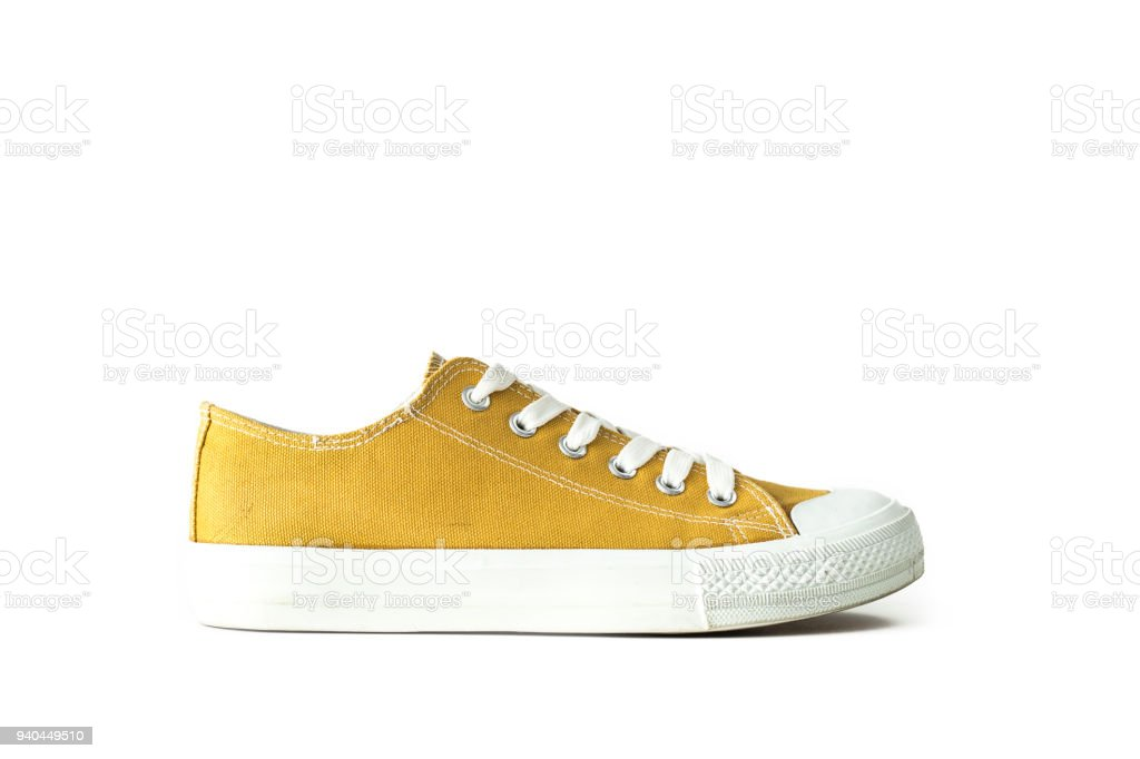 0b2ccd433655aa Yellow unisex sneaker sports footwear isolated white background - Stock  image .