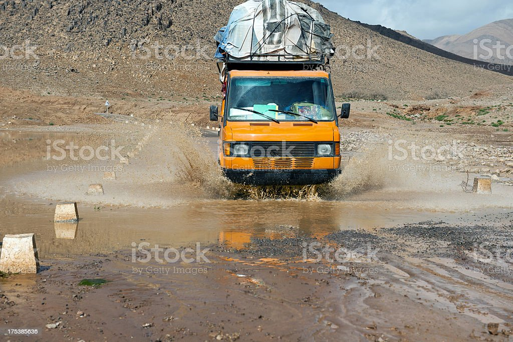 Yellow Van Crossing Flooded Road royalty-free stock photo