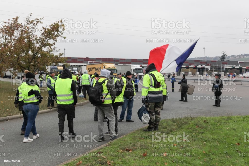 Villefranche en Beaujolais, France - November 19, 2018: Yellow vests protest against higher fuel prices and block motorway in France stock photo