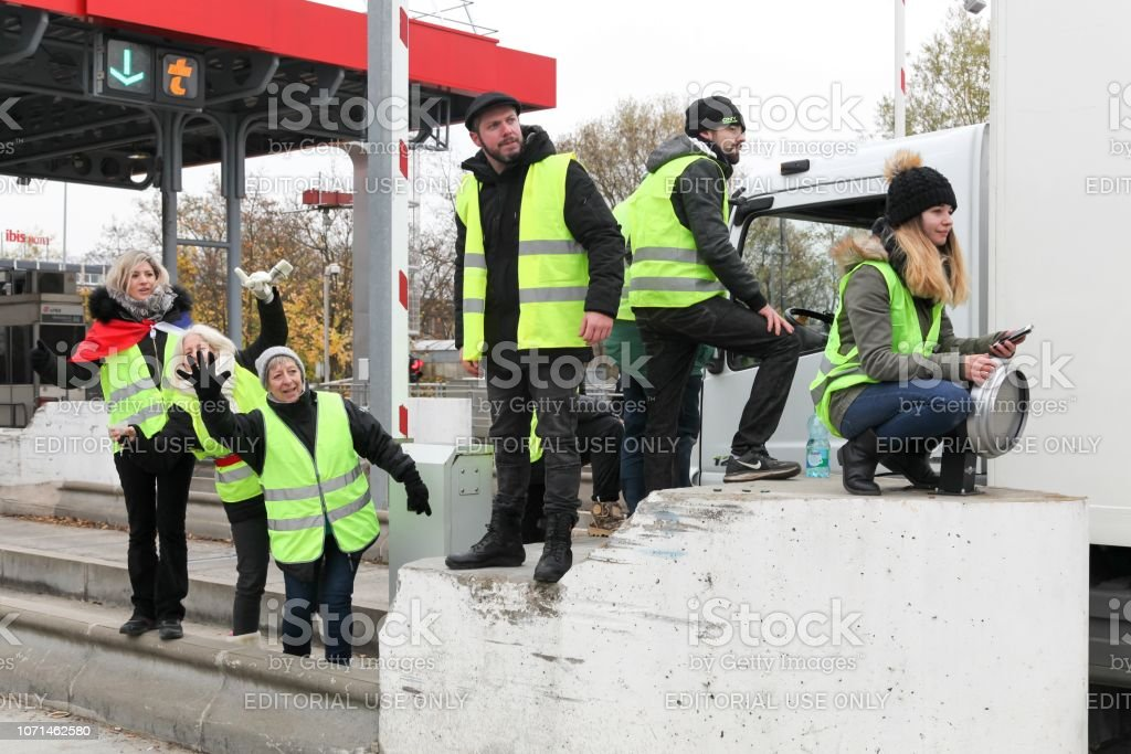 Yellow vests protest against higher fuel prices and block motorway in Villefranche en Beaujolais, France stock photo
