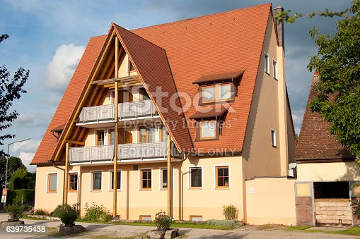 Nuremberg, Germany - January 1, 2010: luxury family home in evening sun. Building has a high roof and stands in the east of the city Nuermberg