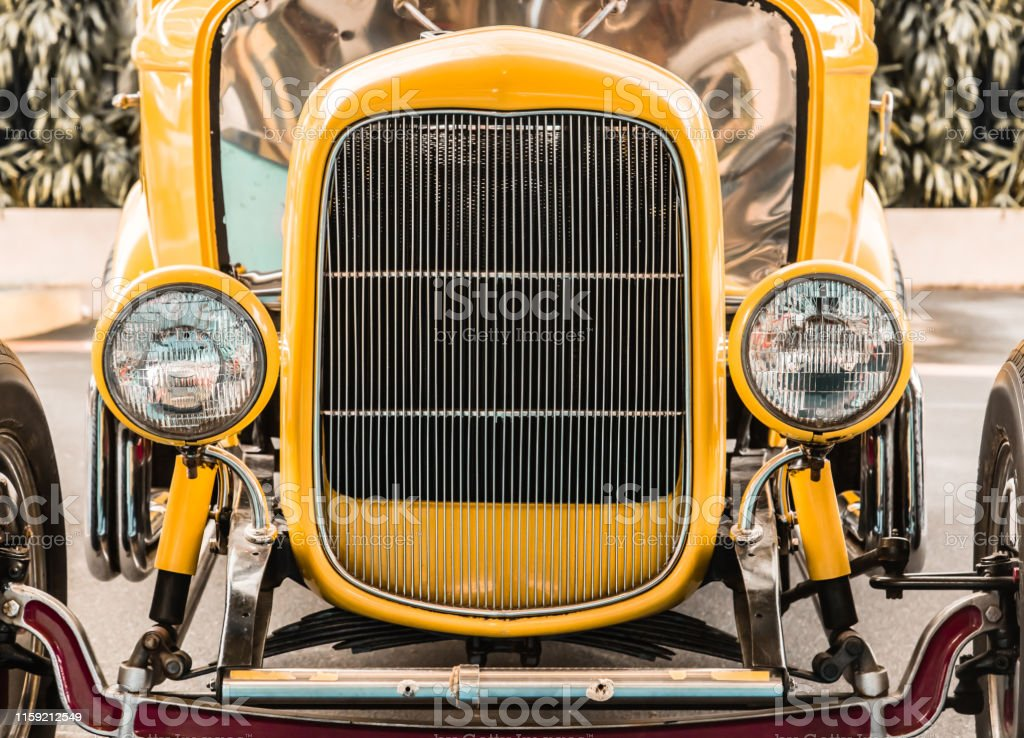 yellow color vintage car head view from front