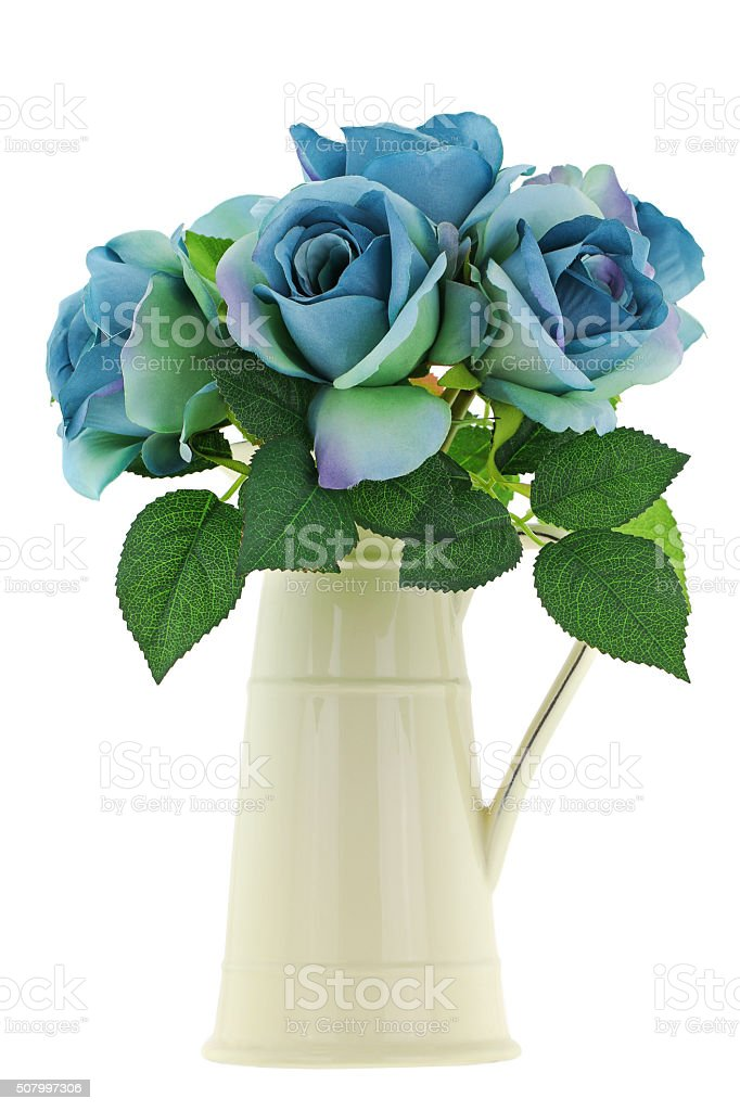 Yellow vintage enamel ceramic jug vase with blue green roses stock photo