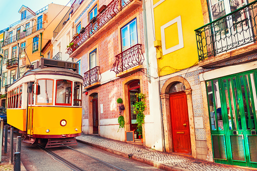 Yellow vintage tram on the street in Lisbon, Portugal.