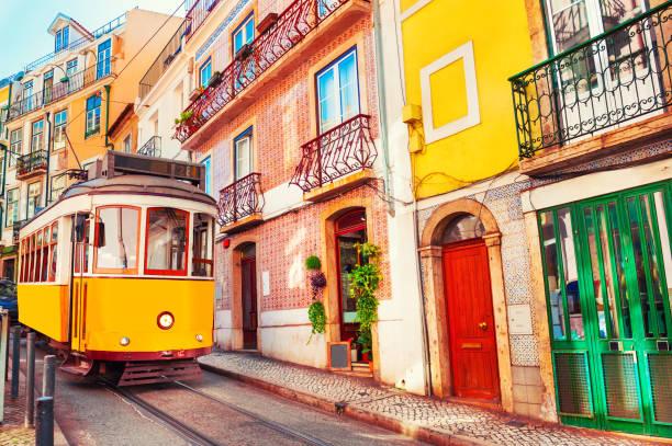 yellow vintage tram on the street in lisbon, portugal. - portugal imagens e fotografias de stock