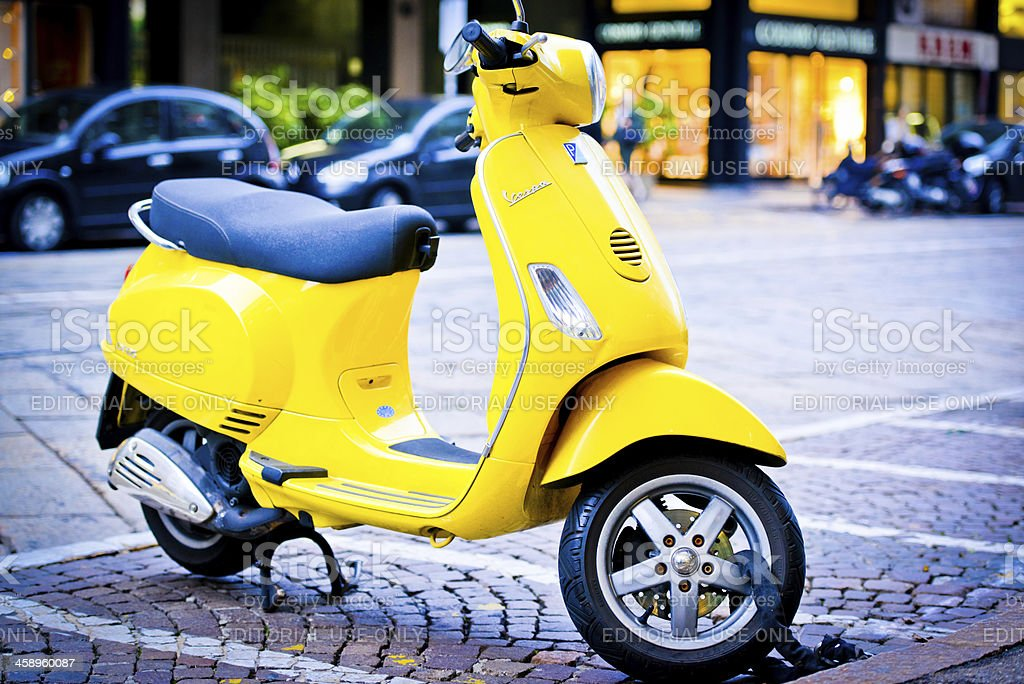 Yellow Vintage Vespa Scooter parked on Milan Street stock photo