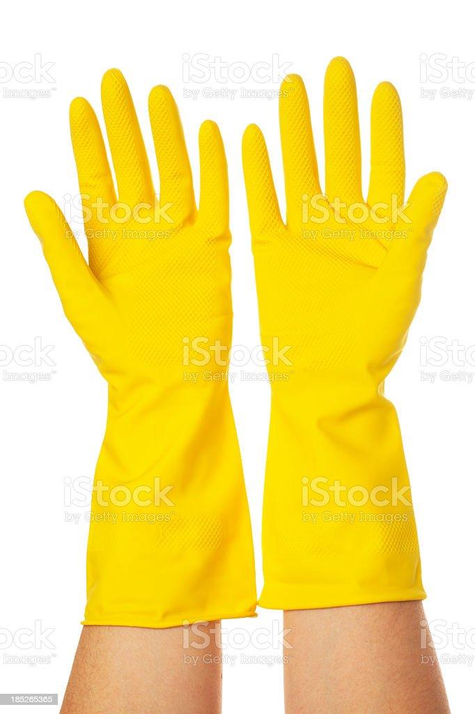 yellow vinyl glove stock photo