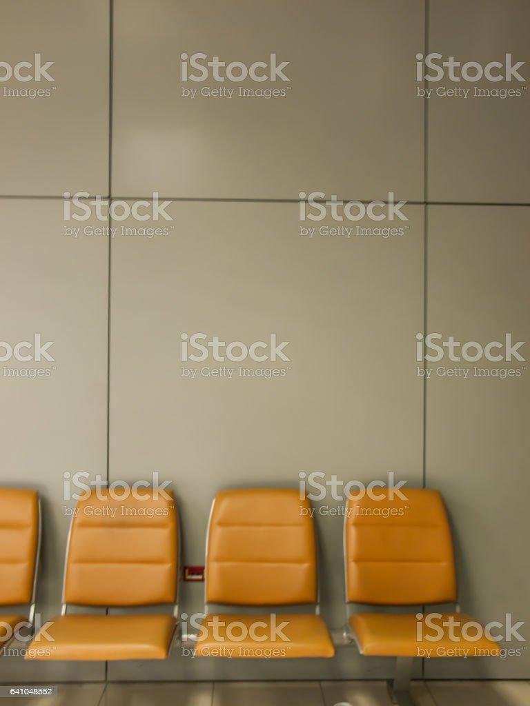 yellow waiting chair stock photo