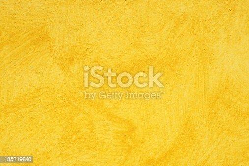 Deep vivid yellow wall background.