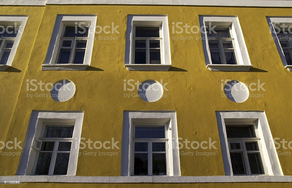 Yellow wall of the house. Russia. royalty-free stock photo