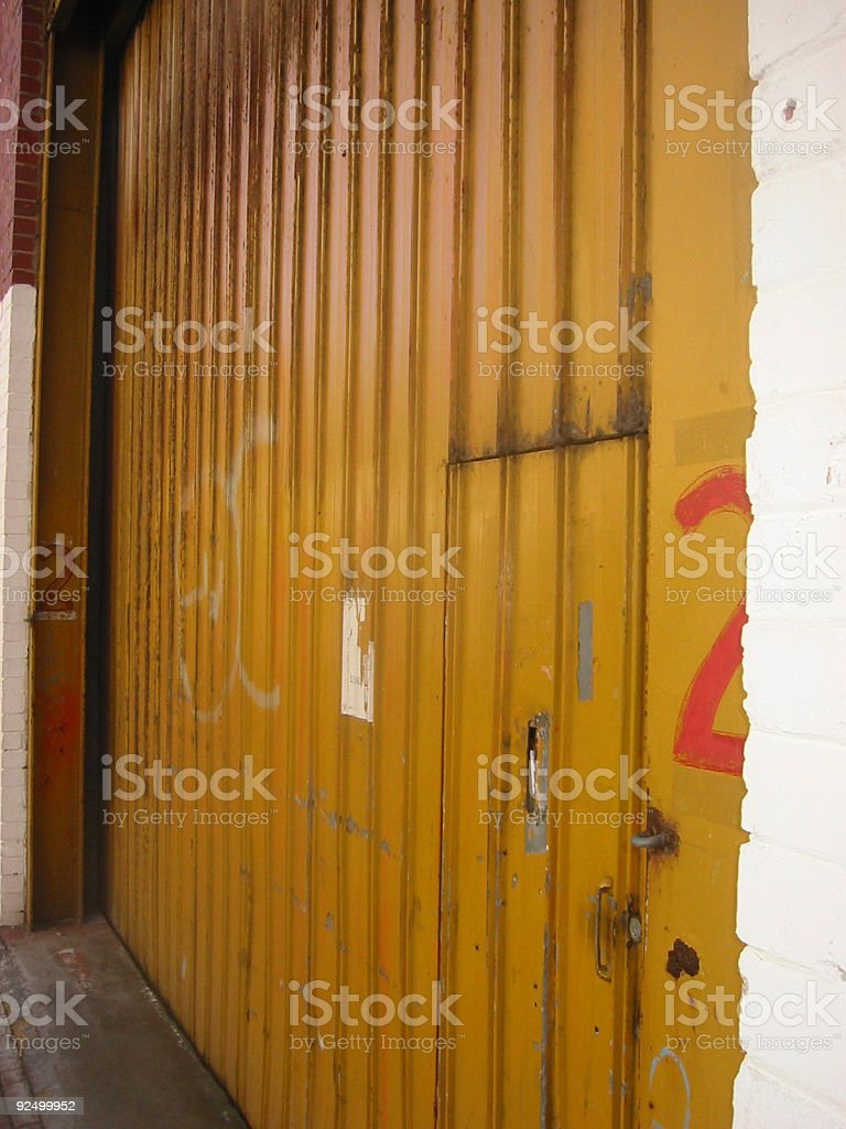 yellow warehouse door royalty-free stock photo