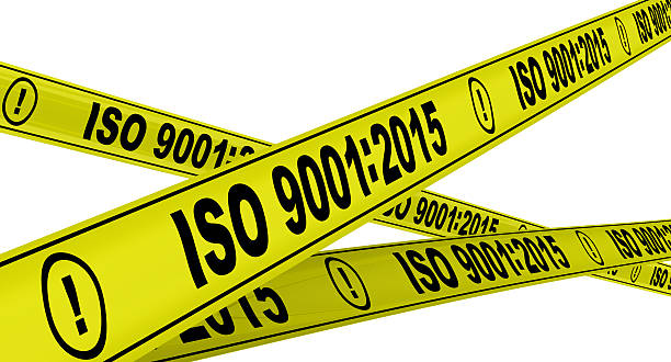 ISO 9001:2015. Yellow warning tapes stock photo