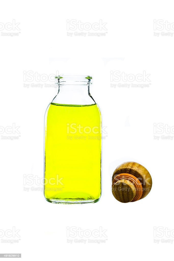 yellow water in glass bottle stock photo