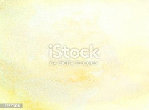 Yellow watercolor abstract  background on white watercolor paper. My own work.