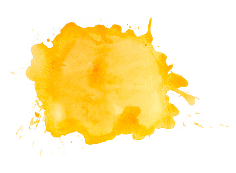 Yellow watercolor spot with splashes on white watercolor paper. My own work.