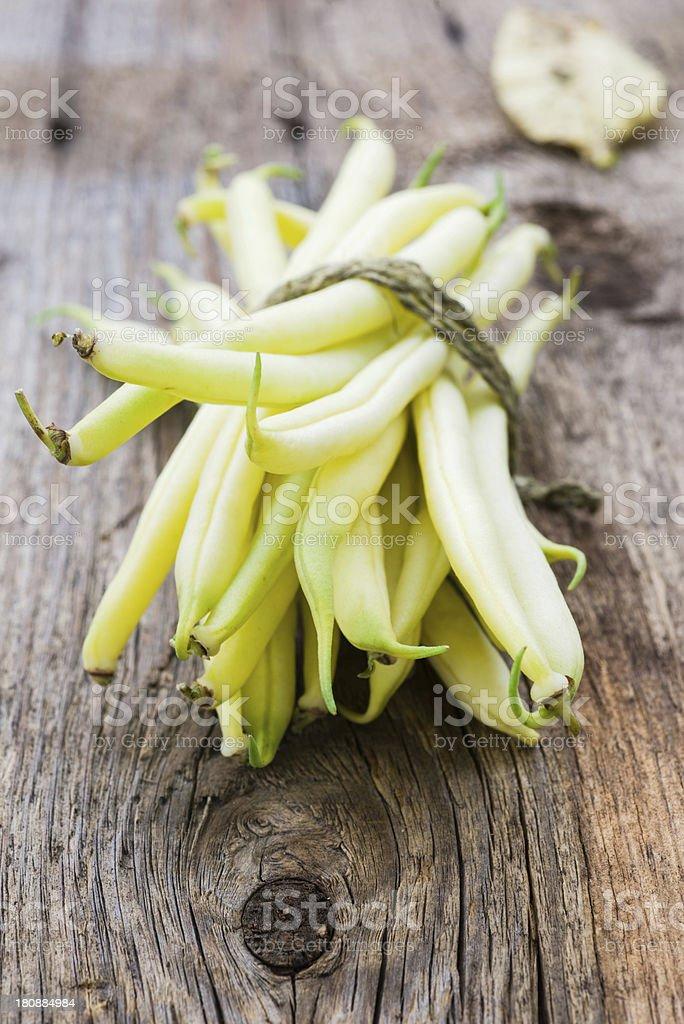 Yellow wax bean on wooden table stock photo
