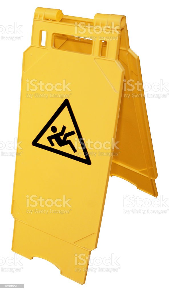 Yellow wet floor sign on isolated white background stock photo