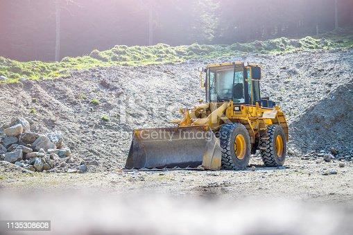 Wheel loader excavator is parking in a quarry