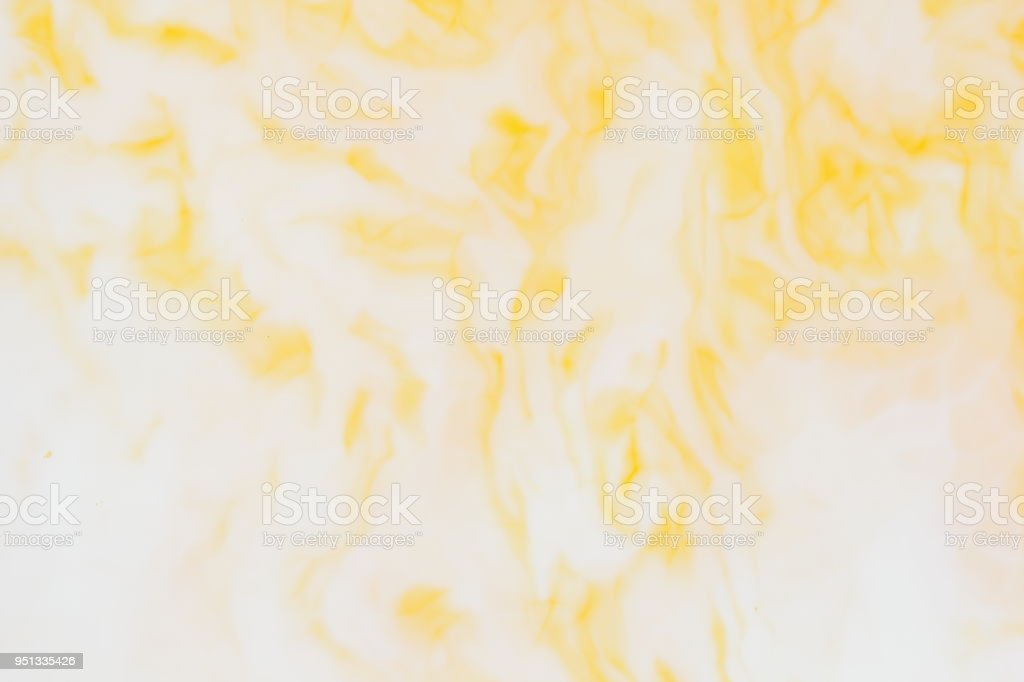 Yellow white abstract background, yellow pattern of paints on liquid, blank for designer, paint divorces in milk, bright texture on white background, minimalism, creative blank for wallpaper, art stock photo