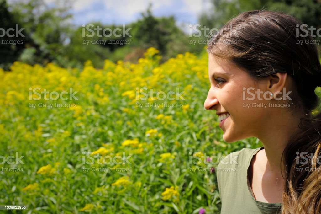 Yellow wildflower Canadian goldenrod with Russian outdoor girl stock photo