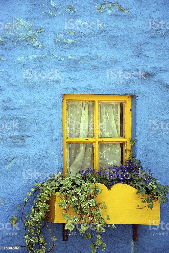 Yellow window, blue facade royalty-free stock photo