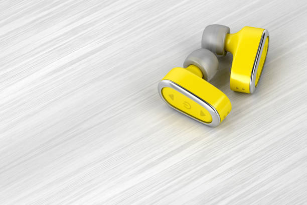 casque sans fil jaune - écouteurs intra auriculaires photos et images de collection