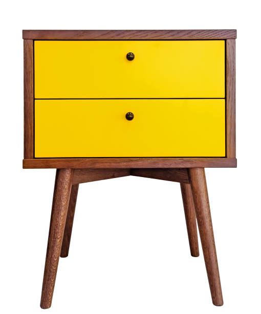 Yellow wood bedside table. Modern designer nightstand isolated on white background front view. cabinet with two drawers Yellow wood bedside table. Modern designer nightstand isolated on white background front view. cabinet with two drawers. bed furniture stock pictures, royalty-free photos & images