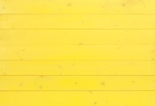 An overhead view of a painted yellow wooden panel. XXXL file