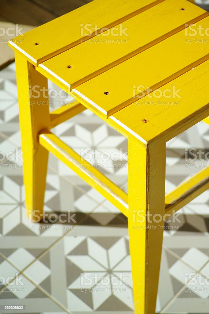 Yellow Wooden Chair And Ornamental Floor Abstract Background stock photo