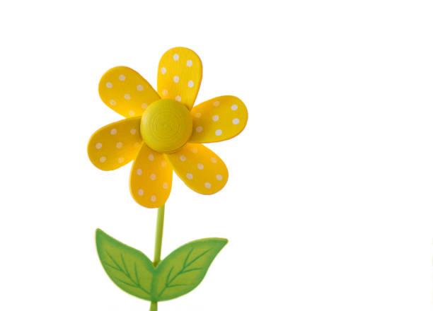 yellow wooden daisy toy stock photo