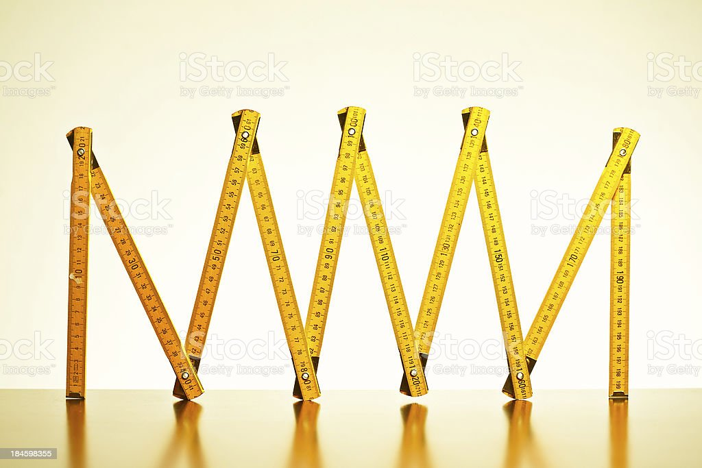 Yellow wooden, folded meter stock photo