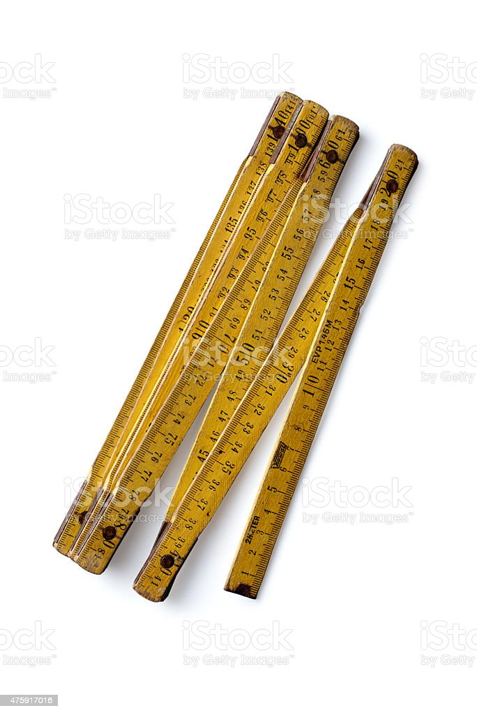 Yellow wooden folding ruler on a white background stock photo