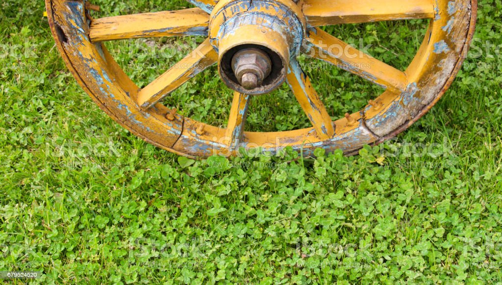 yellow wooden wagon painted wheels royalty-free stock photo