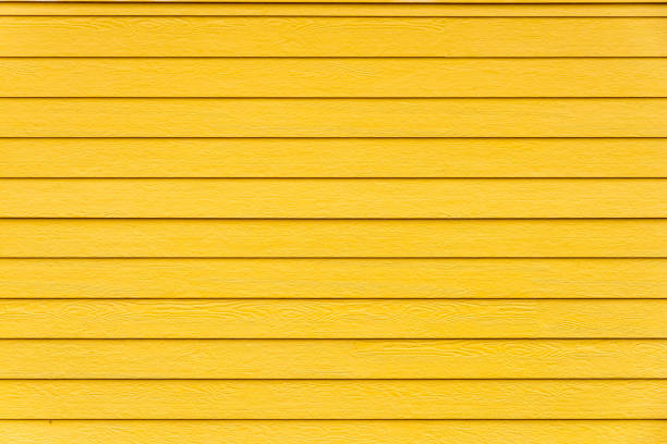 yellow wooden wall - yellow stock photos and pictures