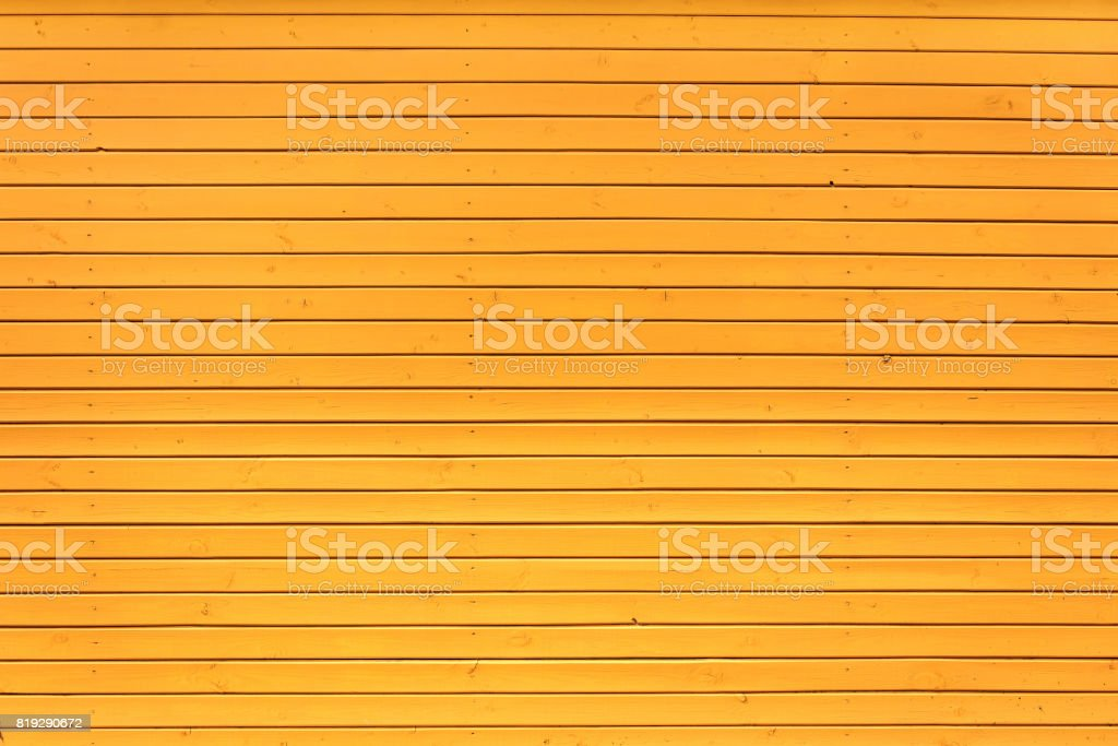 Yellow wooden wall texture stock photo